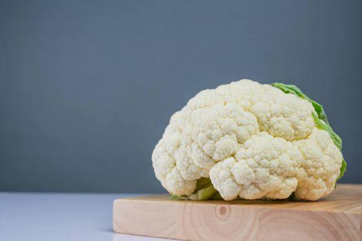 Cauliflower on the wooden floor.