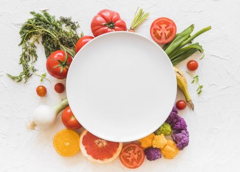 white-empty-frame-over-the-colorful-vegetables-on-backdrop